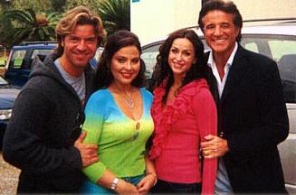 """Paolo Conticini, Ornella Muti, Sofia Milos and Cristian De Sica on the set of """"Lo Zio D'America"""" (""""The Uncle From America""""). The miniseries for RAI, was filmed in Rome."""